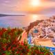 Sunset over Oia town on Santorini island in summer. Santorini, Greece - PhotoDune Item for Sale