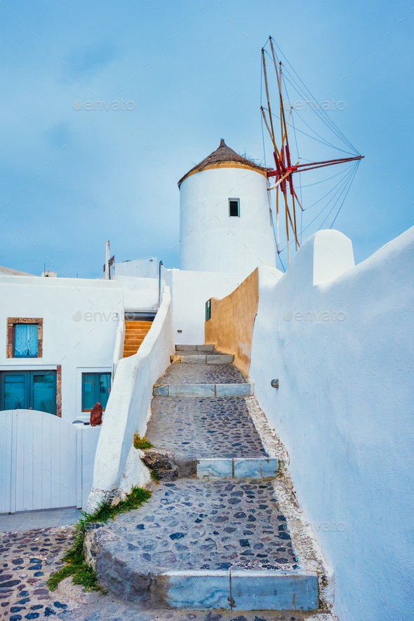 Old greek windmill on Santorini island in Oia town with stairs in street. Santorini, Greece - Stock Photo - Images
