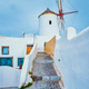 Old greek windmill on Santorini island in Oia town with stairs in street. Santorini, Greece - PhotoDune Item for Sale