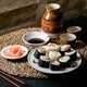 Homemade sushi rolls set with salmon, japanese omelette, avacado and soy sauce - PhotoDune Item for Sale