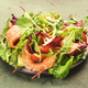 Salmon salad with arugula, beet leaves, radicchio, tomatoes, lemon and olive oil dressing. - PhotoDune Item for Sale