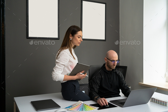 Two colleagues working concentrated at laptops in the office - Stock Photo - Images