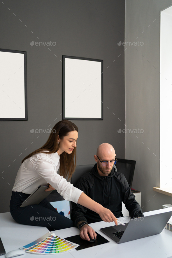 Two colleagues discussing new information about products - Stock Photo - Images