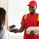 Black delivery man holding pizza box and pos terminal - PhotoDune Item for Sale