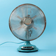 Vintage tabletop fan isolated on a blue background - PhotoDune Item for Sale