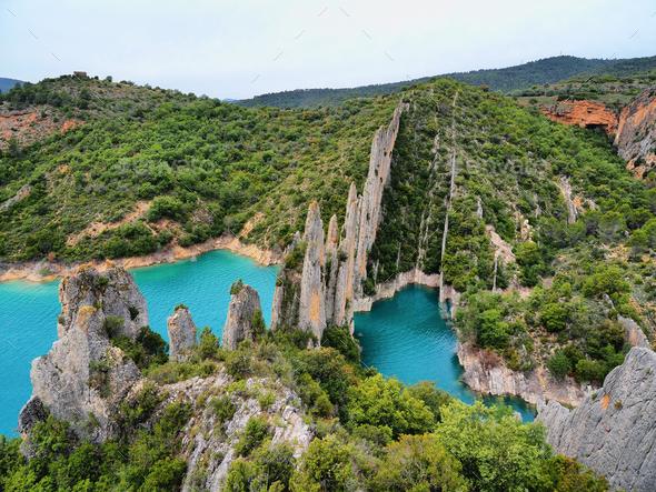 Amazing sharp rocks near Finestras uninhabited village at the edge of Canyelles reservoir, Spain - Stock Photo - Images