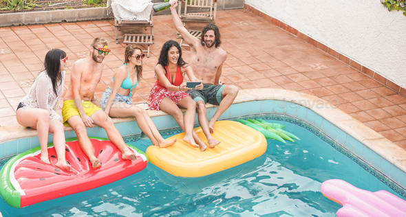 Happy friends celebrating taking photo selfie at swimming pool party - Stock Photo - Images