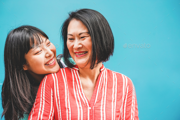 Asian mother and daughter having fun outdoor - Happy family people enjoying time togehter - Stock Photo - Images