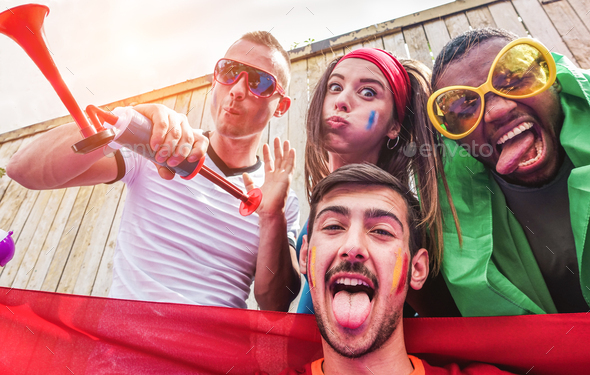Happy sport supporters having fun during football world game - Stock Photo - Images
