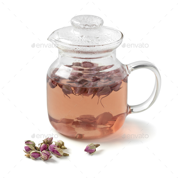 Glass teapot with dried rose buds tea on white background - Stock Photo - Images