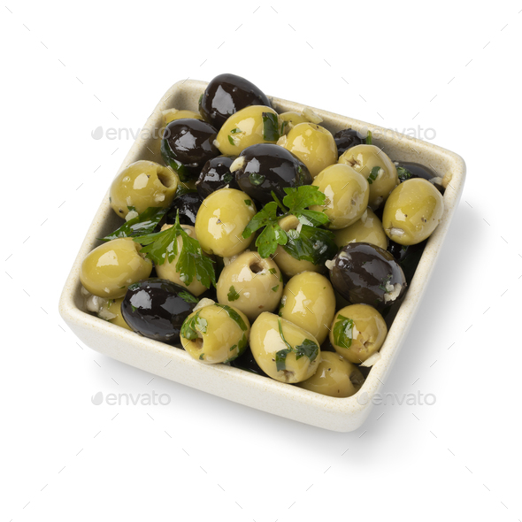 Bowl with green and black olives seasoned with garlic and herbs on white background - Stock Photo - Images