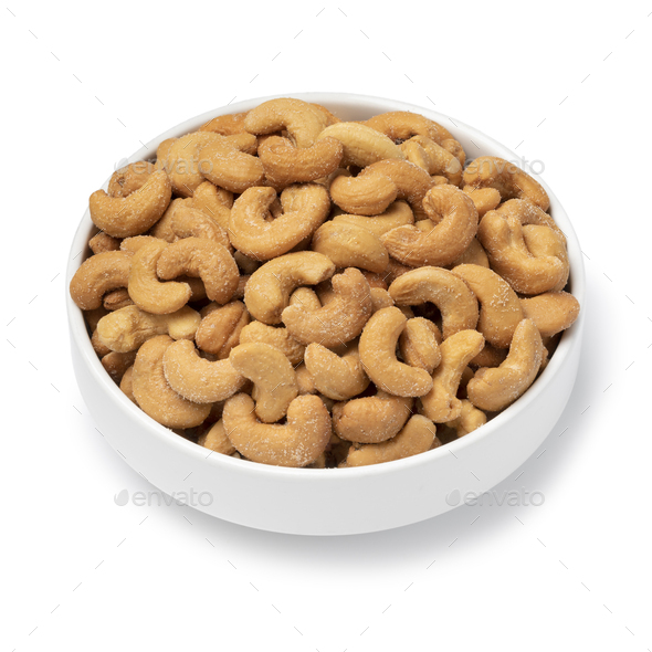 White bowl with with salted cashew nuts close up on white background - Stock Photo - Images