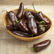 Basket with whole fresh chocolate mini pointed bell peppers close up - PhotoDune Item for Sale