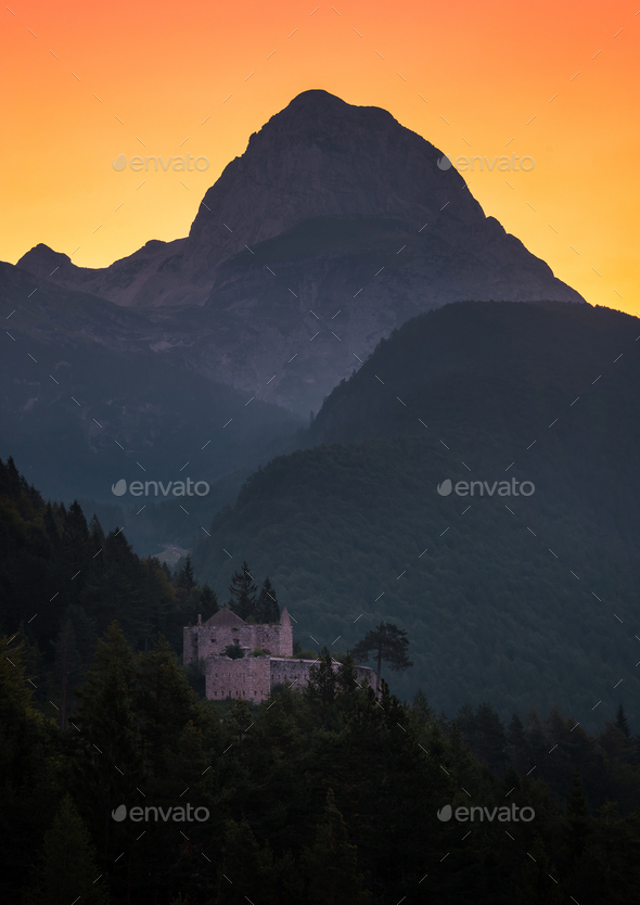 Castle below the Mangart mountain at sunrise - Stock Photo - Images