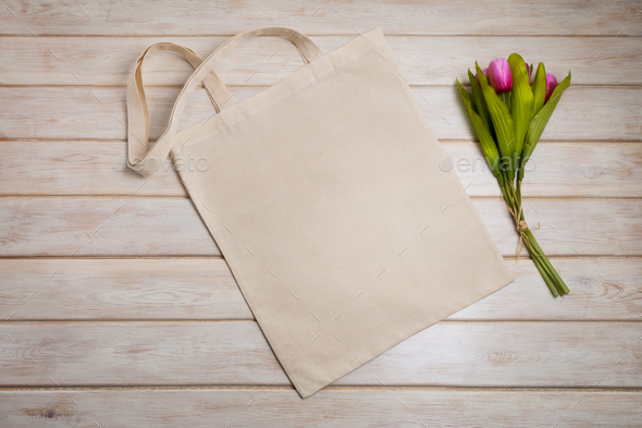Tote bag mockup with pink tulips bouquet - Stock Photo - Images