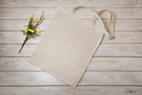 Tote bag mockup with yellow decorated branch - Stock Photo - Images