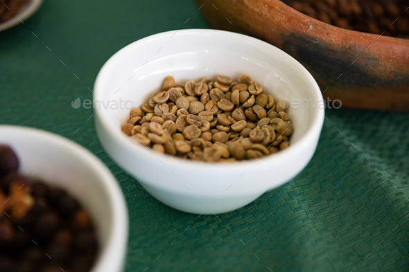 Bowls of beans showing the process of coffee production - Stock Photo - Images