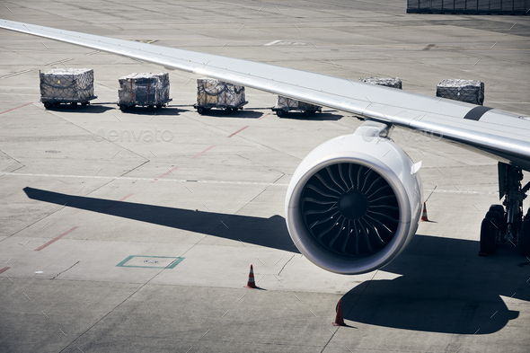Loading of cargo containers to plane at airport - Stock Photo - Images