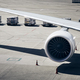 Loading of cargo containers to plane at airport - PhotoDune Item for Sale
