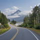 Camper travels along a curving highway in Alaska below mountains near Seward on a sunny afternoon - PhotoDune Item for Sale