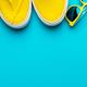 Yellow Baseball Cap, Sunglasses, Sneakers, Mini Cruiser Board On Blue Background - PhotoDune Item for Sale