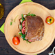 Big sandwich with pieces of meat, arugula, tomato, cereal ciabatta - PhotoDune Item for Sale