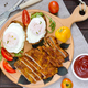 Pieces of chop (schnitzel), toast with eggs, fresh tomato - PhotoDune Item for Sale