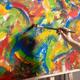 Male artist working on painting. Man artist painter in creative studio - PhotoDune Item for Sale