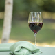 A glass of wine and a wrapped glass sit on a table for a Jewish wedding - PhotoDune Item for Sale