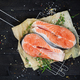 Salmon steak on black wooden table top view - PhotoDune Item for Sale