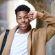 Young black man looking at camera outdoors - PhotoDune Item for Sale