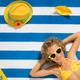 Top view portrait of child on striped beach towel - PhotoDune Item for Sale