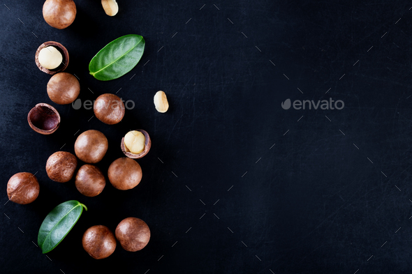 Australian peeled and whole macadamia nut with green leaves - Stock Photo - Images
