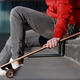 man longboarder in casual clothes resting on the steps, sitting with longboard/skateboard outdoors - PhotoDune Item for Sale