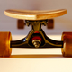 Closeup of wooden longboard wheel and suspension elements - PhotoDune Item for Sale