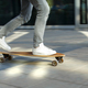 Male skateboarder riding and practicing longboard in the city, outdoors, in motion, cropped image - PhotoDune Item for Sale
