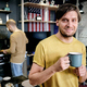Smiling guy having drink in the kitchen - PhotoDune Item for Sale