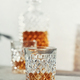 Glasses of whiskey with ice cubes and carafe close up - PhotoDune Item for Sale