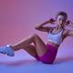 Sportswoman on training in studio, neon background - PhotoDune Item for Sale