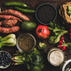 Vegetables, grains, greens and fruit over dark rusty background - PhotoDune Item for Sale