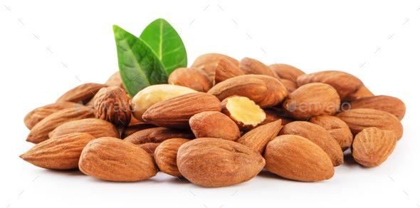 Heap of almonds with green leaves isolated on white - Stock Photo - Images