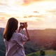 Young woman traveler taking a beautiful sunset over the mountains, Travel lifestyle concept - PhotoDune Item for Sale