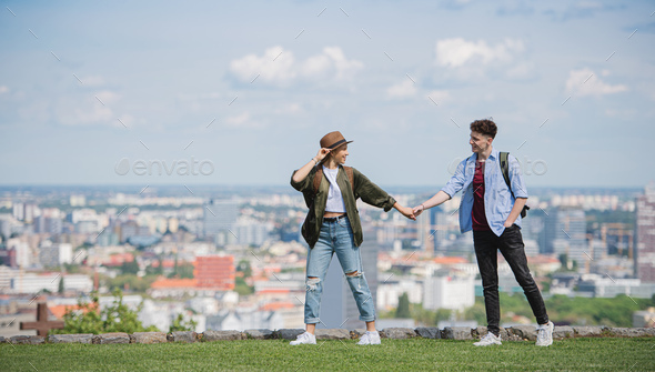 Young couple travelers with map in city on holiday walking and holding hands - Stock Photo - Images