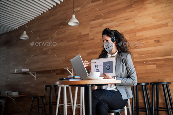 Businesswoman with laptop working in cafe, freelance work and video call concept - Stock Photo - Images