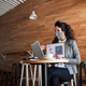 Businesswoman with laptop working in cafe, freelance work and video call concept - PhotoDune Item for Sale