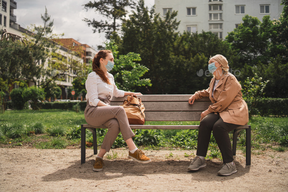 Portrait of young woman with grandmother outdoors in city, covid-19 and social distancing concept - Stock Photo - Images