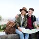 Young couple travelers with map in city on holiday, resting and planning - PhotoDune Item for Sale