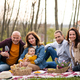 Happy multigeneration family outdoors having picnic in nature - PhotoDune Item for Sale