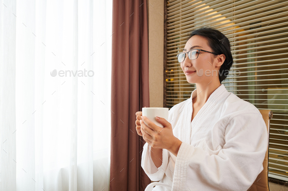 Pretty woman drinking morning coffee - Stock Photo - Images