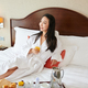 Woman enjoying hotel breakfast - PhotoDune Item for Sale